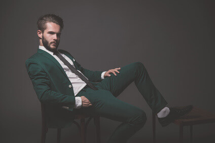 Business fashion man wearing green suit with white shirt black