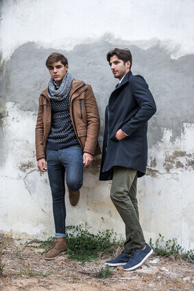Portrait of two young man posing with fashionable winter clothes