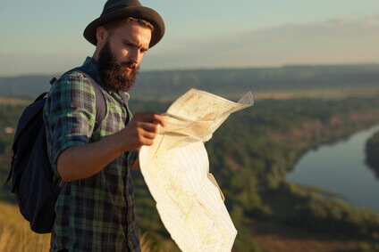 Traveler reading map on nature