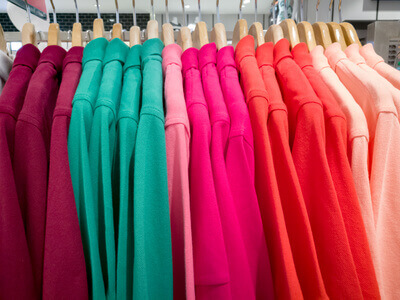 row of colorful shirt in shopping mall